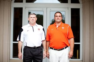 "Assistant head coach Johnny Burnett (left) and head coach Justin ""Buck"" Buchanan are leading the only Division III college football program in Arkansas. Courtesy: Sync"