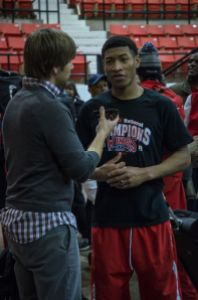 Justin McCleary talks to me while wearing a shirt repping the Arkansas Wings, the AAU program for which the Lee bros will play this summer.  Photo by Matt McClenahan.