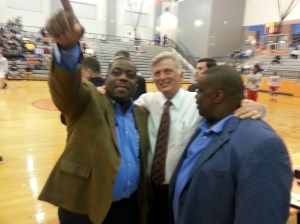 Rep. Reginald Murdock (Marianna) points while Gov. Mike Beebe and Real Deal co-founder Bill Ingram look on