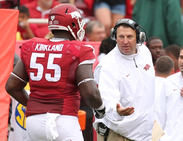 Arkansas Razorbacks head coach Bret Bielema celebrates after a score with offensive lineman Denver Kirkland. (Nelson Chenault / USA TODAY Sports)